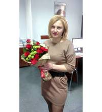 Delivered in Borispol elongated bouquet in red and green scheme
