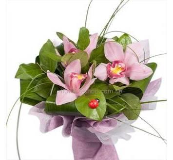 Букет с орхидеями цимбидиум в декоративной упаковке
